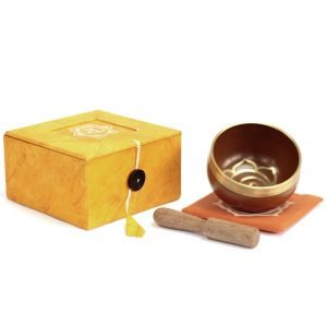 Chakra singing bowl; navel, orange box, with stick and cushion