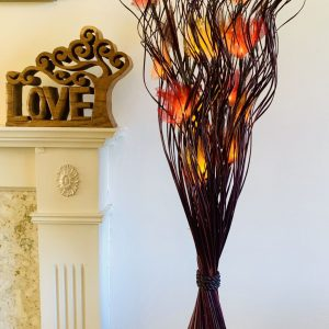 Bouquet Light with red, orange and yellow leaves in a brown vase