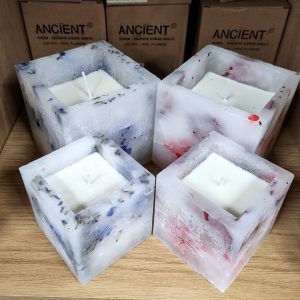 Group of 4 fragrant blossom candles in fragrances, each in 2 sizes