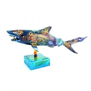 painted shark on a stand